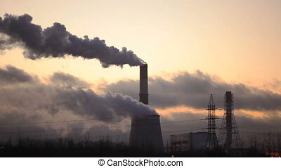 thermal power station cold winter evening - smoking chimneys...