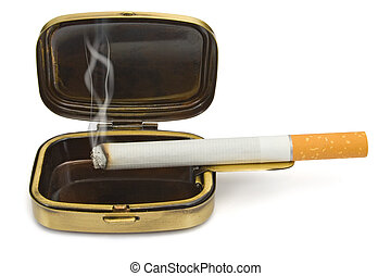 Smoking cigarette in compact ashtray