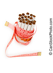 Smoking concept with measuring tape and cigarettes