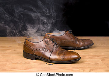 Smoking dress shoes - A pair of dress shoes steaming after a...