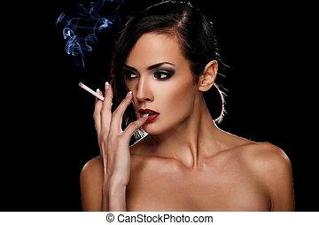 Smoking - Elegant brunette woman smoking a cigarette on ...