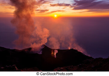 Smoking erupting volcano on Stromboli island at colorful sunset, Sicily