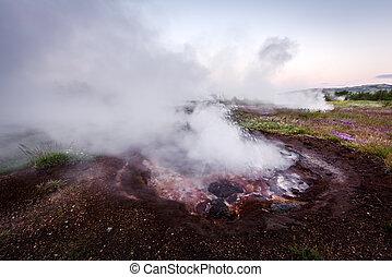 Smoking fumarole on Haukadalur valley near famous Geysir...