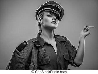Smoking, German officer of the Second World War. Woman with power, dominant and severe