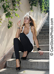 Smoking girl in a sunny day