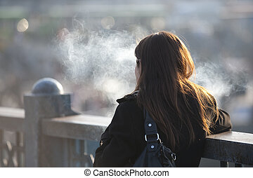 Smoking girl on bridge