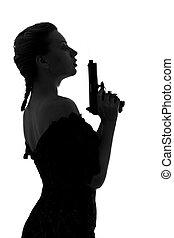 smoking gun - silhouette image of pretty girl with smoking...