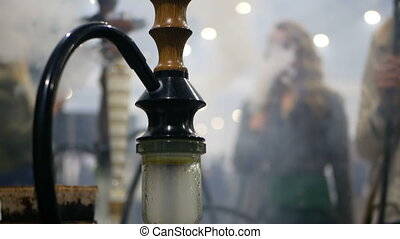Smoking hooka people - A group of people sit in the side of...