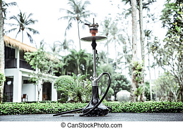 smoking hookah on vacation background lifestyle concept