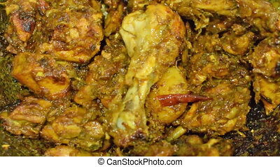 smoking hot chicken curry being made