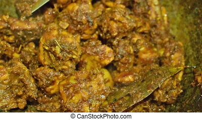 Preparation of smoking hot chicken curry, one of the spicy delicacies of Indian foods. India is famous for such colorful tasty foods for long time.