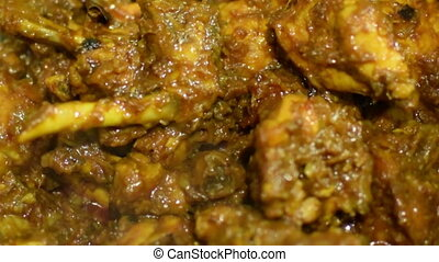 Preparation of smoking hot chicken curry, one of the spicy delicacies of Indian foods. India is famous for such colorful foods for long time.