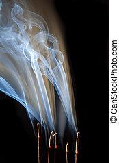 Smoking incense - Incense burning with beautiful smoke fumes...