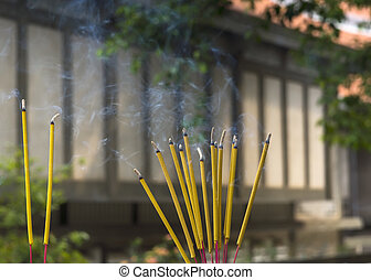 Smoking incense sticks at Jade Emperor Pagoda in Saigon, Vietnam