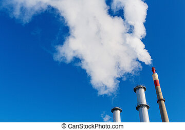 smoking industrial chimney - chimney of an industrial...