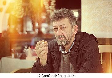 Smoking issues - Adult caucasian man with beard smoking ...