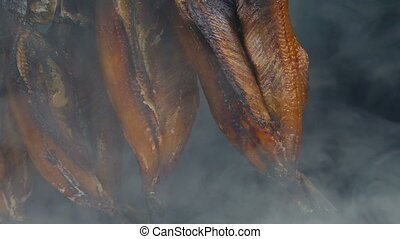 Smoking Kippers Moving Shot - Moving past kippers being...