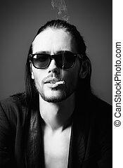 smoking man - Grunge man in black suit and sunglasses...