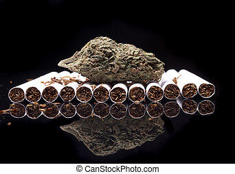 Marijuana and Tobacco Cigarettes on Black Background