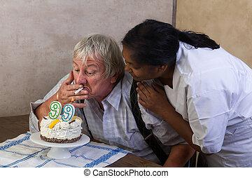 Smoking old man on birthday