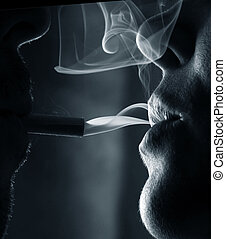 Two silhouettes of smoking people close-up