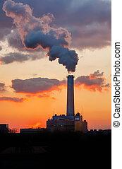Smoking pipe over sunset sky