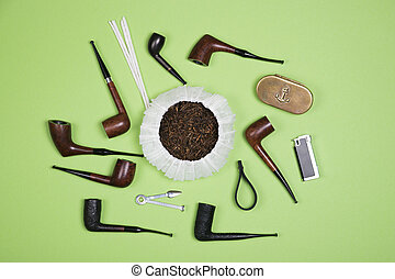 Smoking pipes and pipe smoking accessories. Top view.