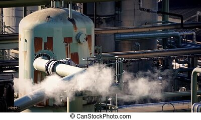 Smoking Pipes At Industrial Plant - Large metal pipes...