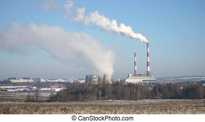 Smoking pipes of the plant or thermal power plant. Looped...