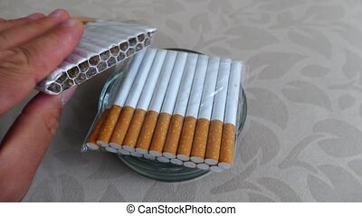 smoking, poor quality cigarette butts in the ashtray,