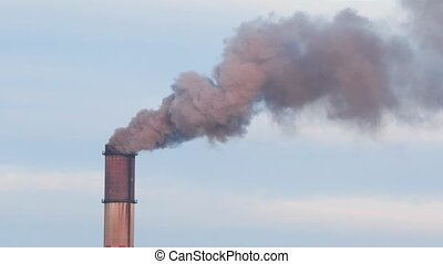 Smoking power plant chimney closeup