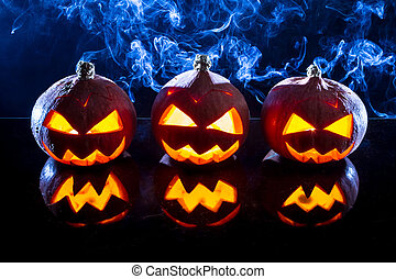 Smoking pumpkins for Halloween holiday