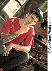 Smoking Rapper - A young Rapper smoking a cigarette.
