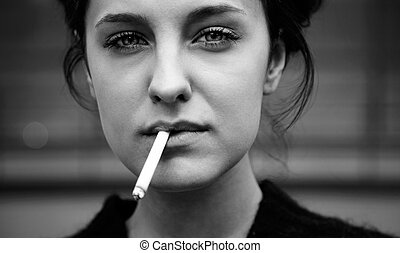 smoking - real young woman smokes on the street, selective...