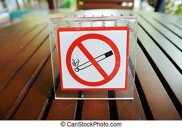 Smoking sign on wood table