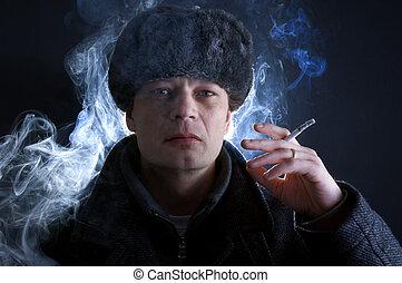 Smoking Soviet - A man, dressed in Soviet attire, smoking a...