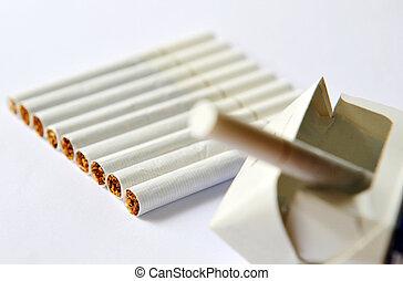 Smoking cigarettes isolated on the white background.