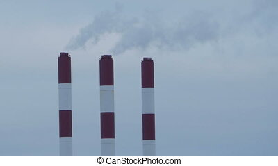 striped chimneys thermal power station - smoking striped...