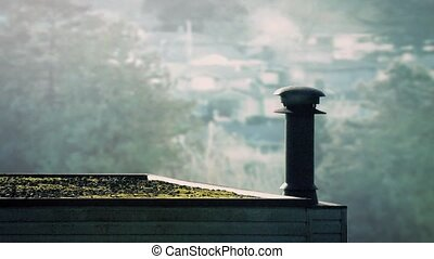 Smoking Vent On Roof In The Morning - Smoke drifts from...