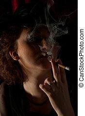 Smoking woman in night