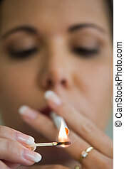 Smoking woman with a cigare