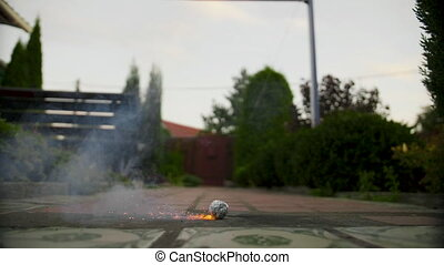 Smoky bomb explosion in slow motion outdoors.