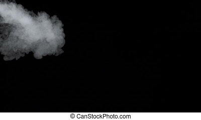 Smoky cloud of e-cigarette on black background