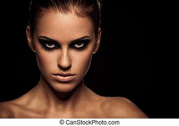 Smoky eye - Closeup portrait of a serious lady with smoky ...