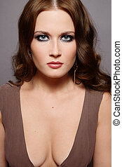 Smoky eyes - Beautiful young woman with long curly hair in ...