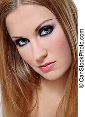 Close-up portrait of beautiful womanl with smoky eyes