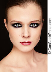 Smoky eyes - Close-up portrait of young beautiful girl with ...