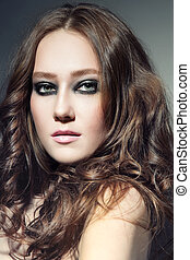 Smoky eyes - Portrait of young beautiful woman with stylish ...