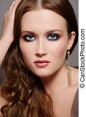 Smoky eyes - Portrait of beautiful young girl with smoky...