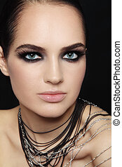 Smoky eyes - Young beautiful tanned woman with smoky eyes